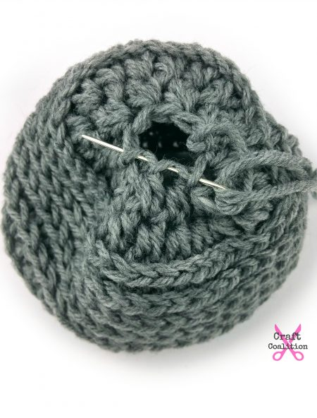 My Dolly Edgy Messy Bun Hat | Free Crochet Pattern | Craft Coalition @craftcoalition.com #freecrochetpattern